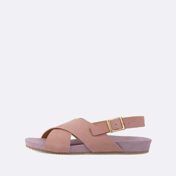 Minimalist cross-strap sandals in light pink leather.