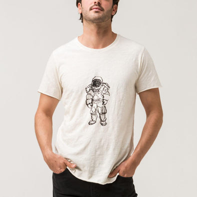 Off-white 100% cotton light tshirt with a rocketman.
