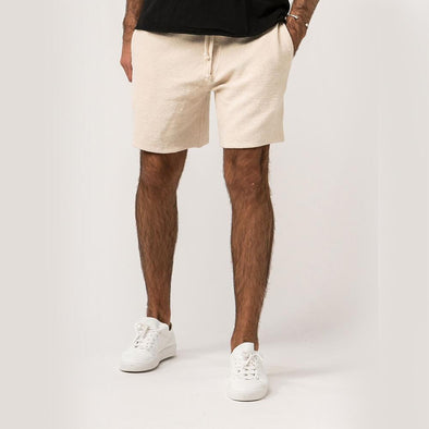 Off-white shorts tailored from a rustic textured cotton-blend.