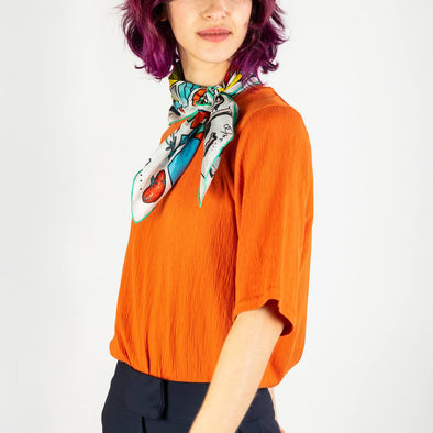 Unisex tangerine round neck stretchy t-shirt featuring a geometric armhole detail.