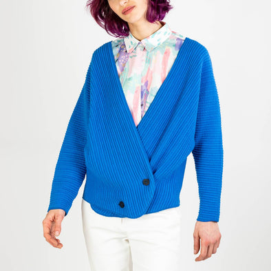 Blue japanese design wrap knit bomber featuring adjustable button fastening at the front.