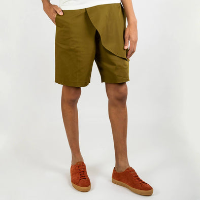 Khaki green shorts with asymetric front detail.