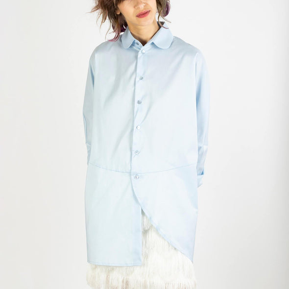 Unisex light blue oversized shirt with asymetric front.
