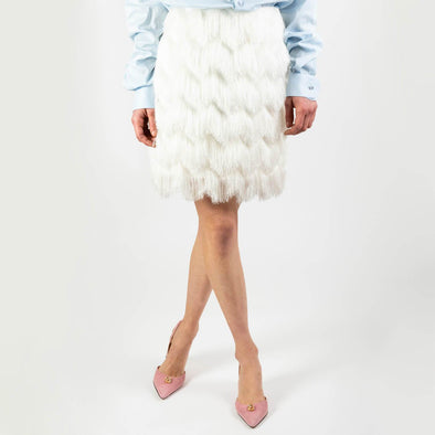 White mini skirt with fringes.
