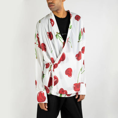 White kimono shirt with cherry print and long sleeves.