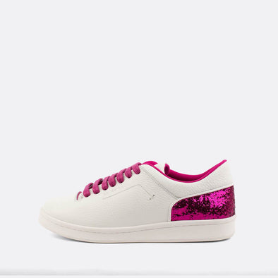 White leather sneakers with pink glitter detailing and pink strings.