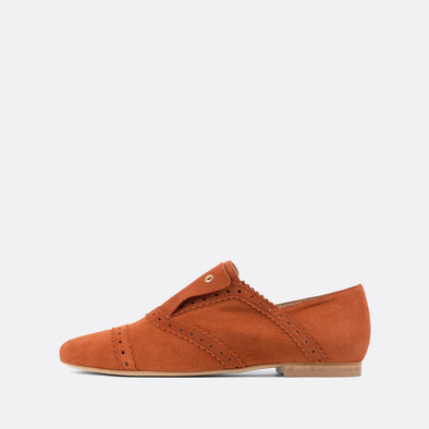 Brick colored suede flat shoes with brogue details.