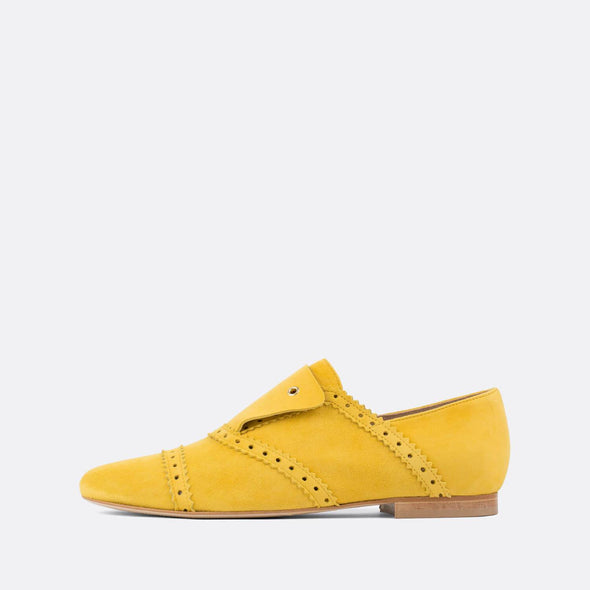 Vibrant yellow suede flat shoes with brogue details.