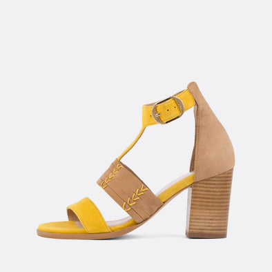 Yellow and beige suede buckle sandals with wooden heel.