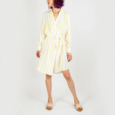 White wrap dress with yellow stripes and cuffed sleeves.