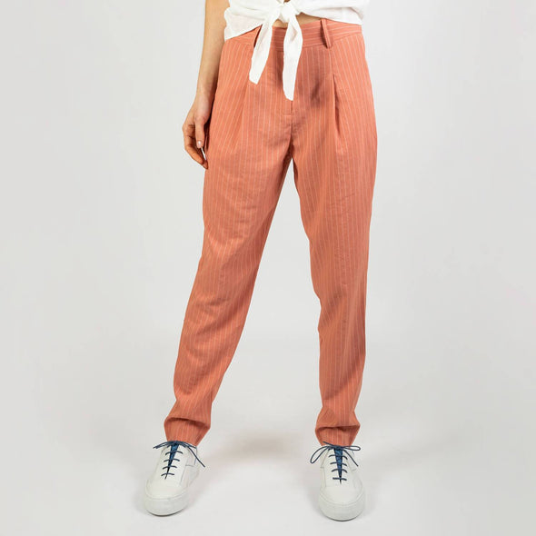 Distinguished soft pink trousers with stripes and an elasticated waistband.