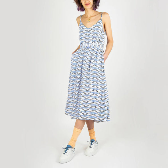 Reversible mid-length dress in a gold and blue pattern on a white background.