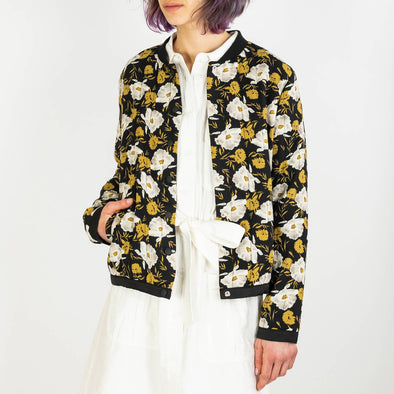 Bomber jacket in a black and gold floral print.