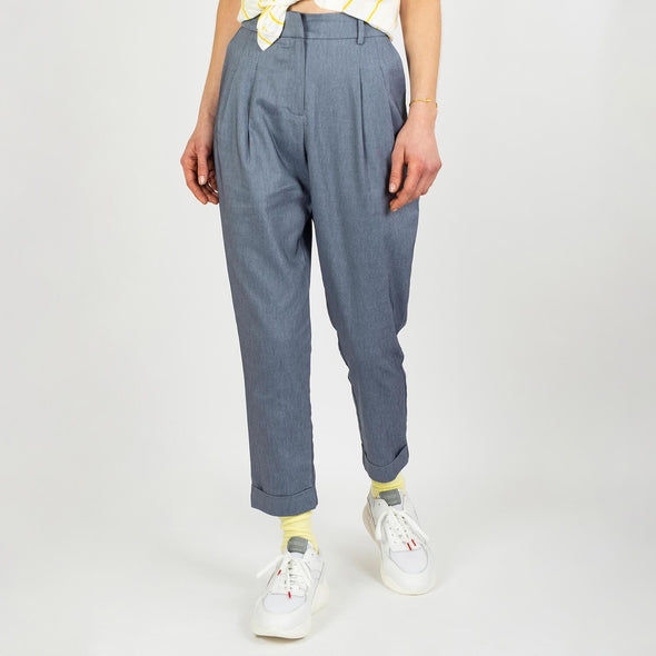 Pleated high waisted trousers in a dull blue shade.