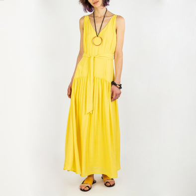 Soft yellow fluid midi dress with a strap to tie at the waist.