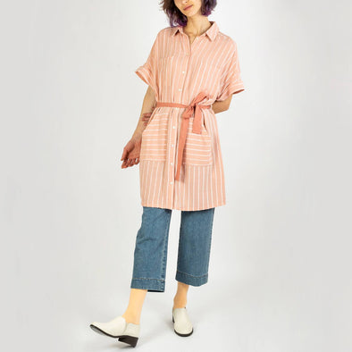 Short pink linen dress with white stripes, a straight cut and multiple pockets.