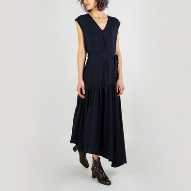 Navy blue belted dress with a flying skirt, fine tone-on-tone stripes and armhole embroidery.