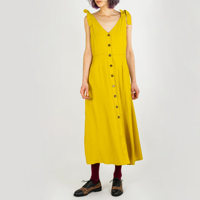 Fluid yellow midi dress with a V-neck and wood buttons.