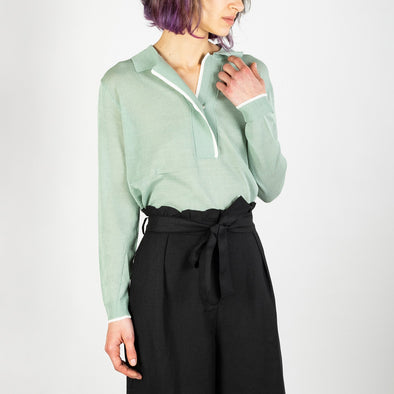 Aqua green light blouse with white details both on the collar and sleeves.