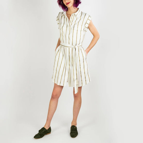 White short dress with gold stripes, shirt collar, full length buttoning and short sleeves.
