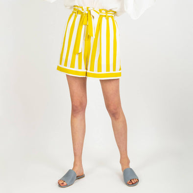 White high waisted shorts with yellow stripes and a strap to tie at the waist.
