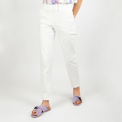 White high-waisted trousers with a slightly curved cut.
