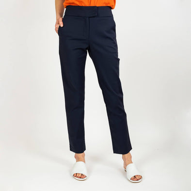 Navy blue high-waisted trousers with a slightly curved cut.