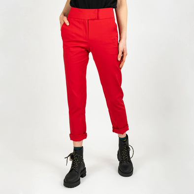 Red high-waisted trousers with a slightly curved cut.