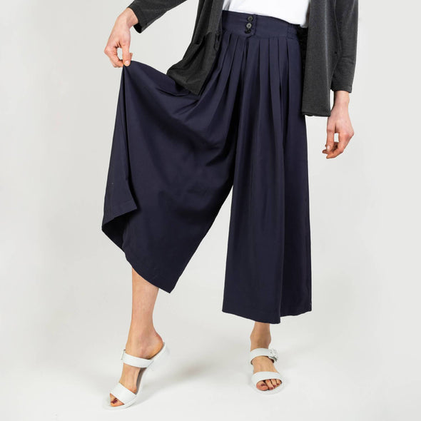 Fluid ankle length navy blue trousers in a retro folk design.