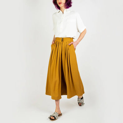 Fluid ankle length khaki trousers in a retro folk design.