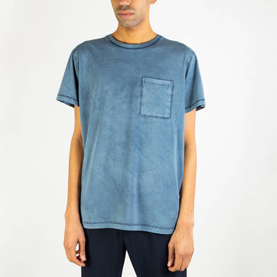 Washed blue 100% cotton tee with chest pocket.