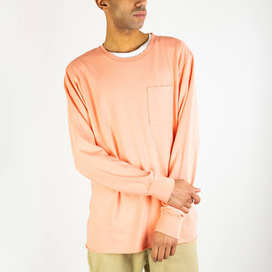 Salmon longsleeve with front pocket and logo on the back.