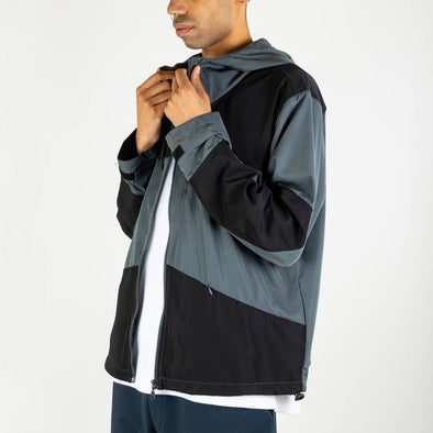 Grey and black water repellent jacket with two front pockets and a two-way YKK zipper.