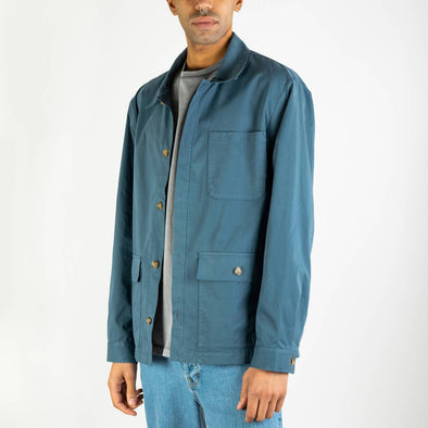 Navy blue chore jacket featureing two exterior patch pockets with a 3rd hidden corduroy pocket.