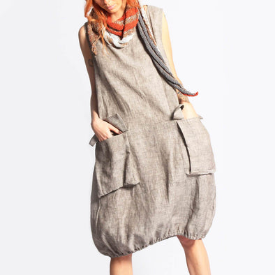 Beige fluid oversized dress with front pockets.