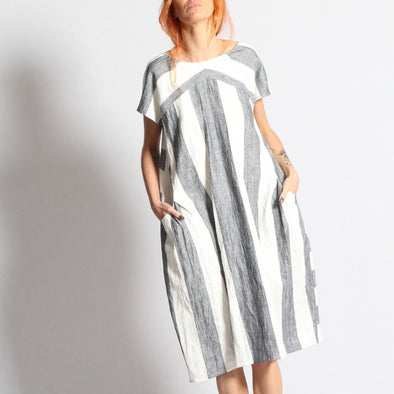 Grey and white striped dress with front pockets.