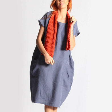 Blue-grey oversized dress with front pockets.