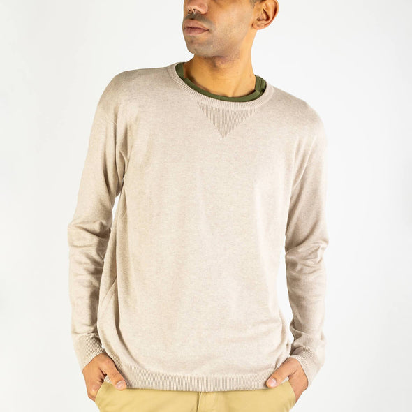 Beige regular fit knitted sweater with a compact, slightly crispy and light touch.