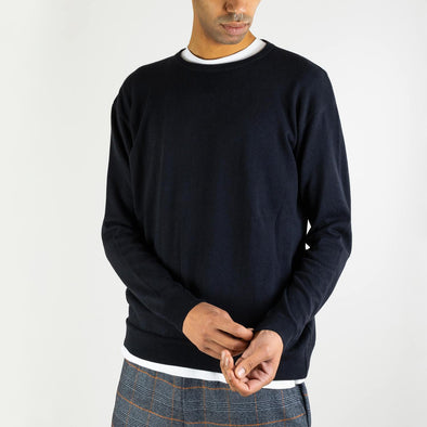 Navy blue regular fit knitted sweater with a compact, slightly crispy and light touch.