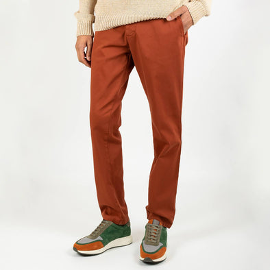 Brick colored regular fit trousers with a light tone on tone texture.