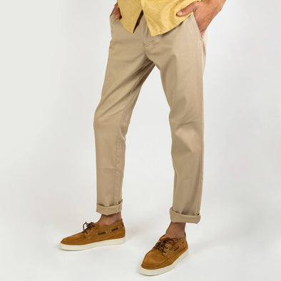 Beige regular fit trousers with a light tone on tone texture.