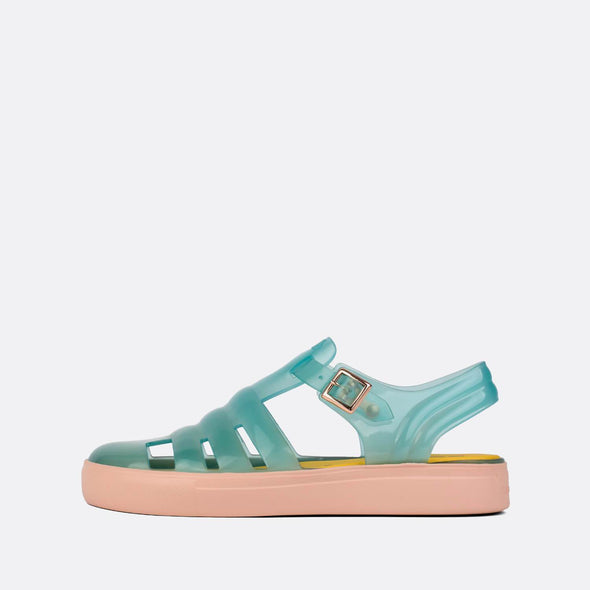 Transparent minty green synthetic 90s style sandals with baby pink sole.