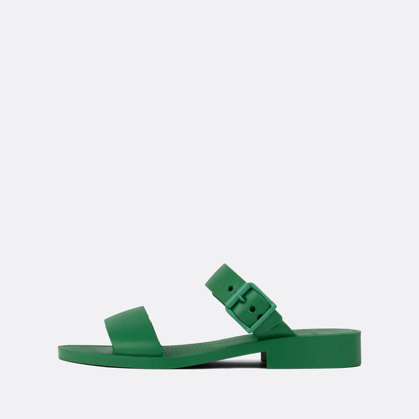 Double strap synthetic slip-ons in leprachaun green.