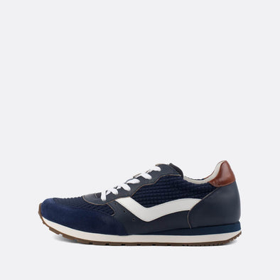 Classic runners in paneled leather and suede in blue shades.