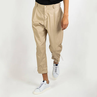 Sand trousers with detailed pocket at the back and ankle drawstrings.