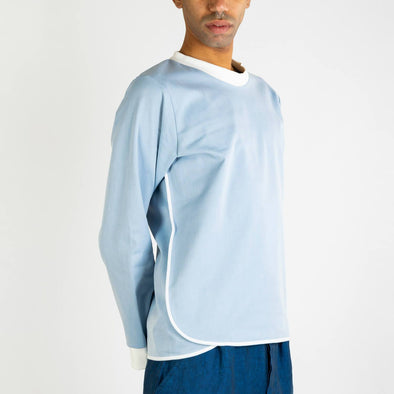 Light blue jumper with white collar and details.