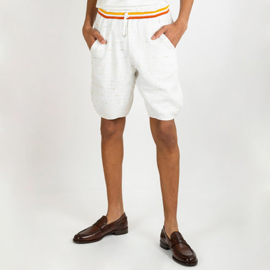 White embroidered shorts with two colored stripes at the waist and a drawstring.