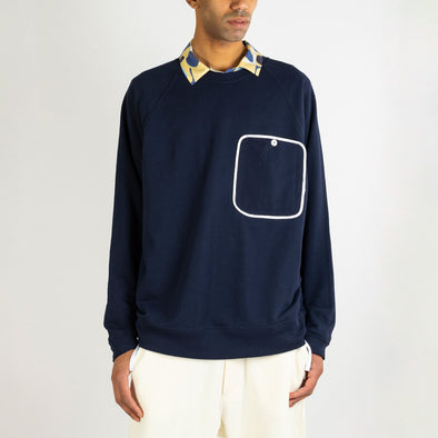 Navy blue sweater with a big white outlined front pocket.