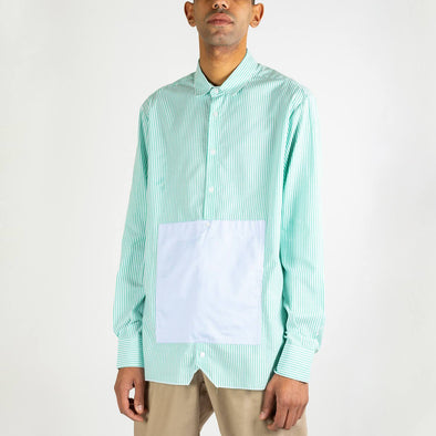 Green and white striped oversized shirt with a light blue kangaroo pocket.