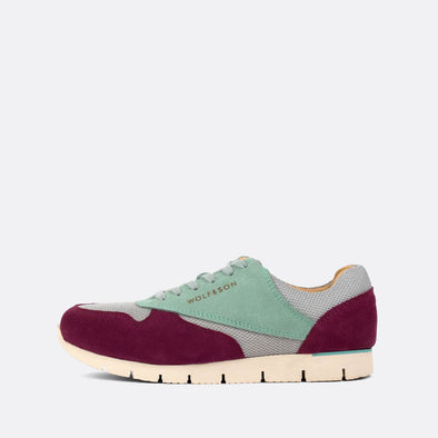 Classic-style runners in paneled purple and aqua green suede and grey mesh.